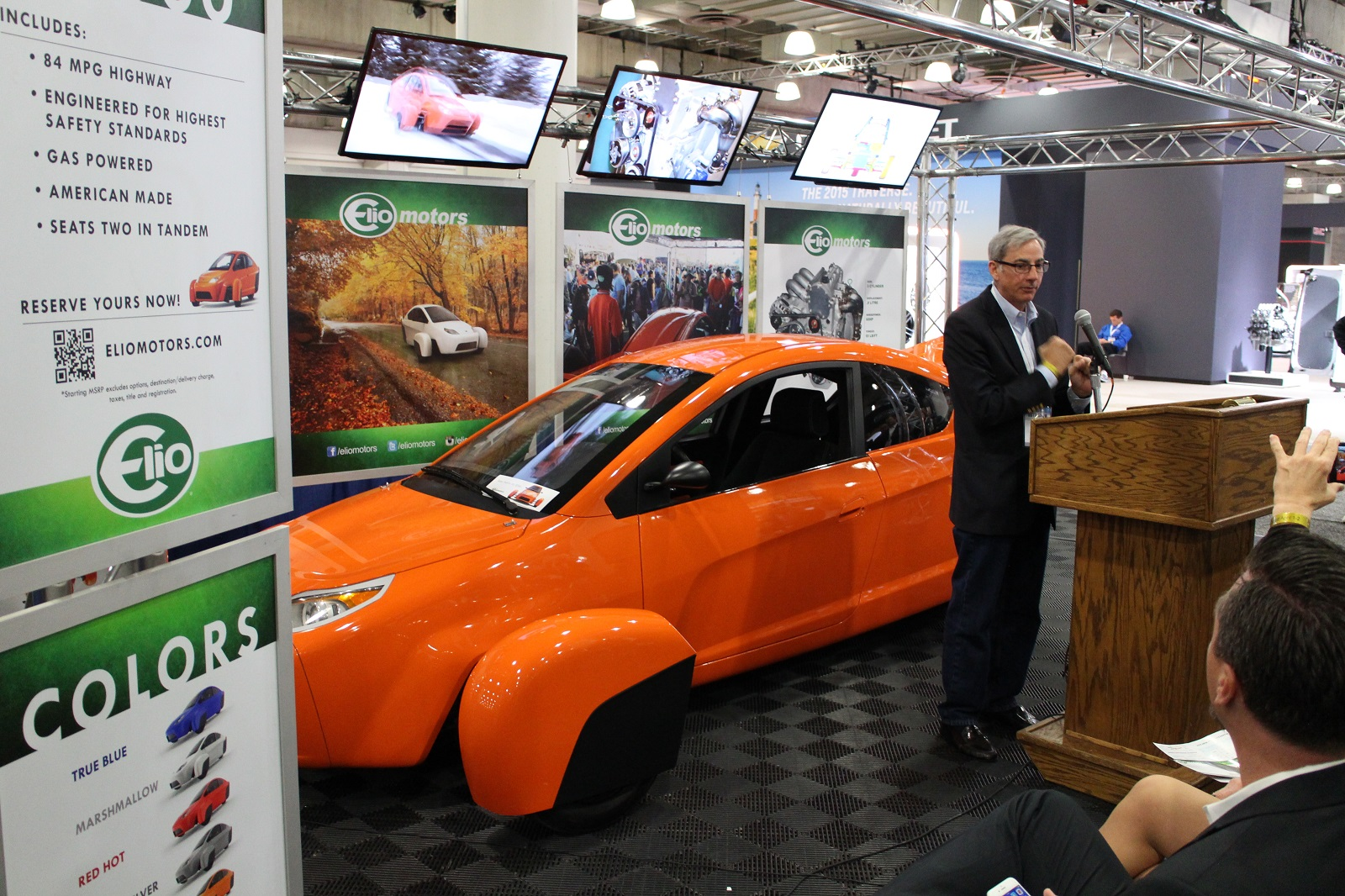 elio motors first ever auto show press event in nyc touts 39 84 mpg 39 three wheel car. Black Bedroom Furniture Sets. Home Design Ideas