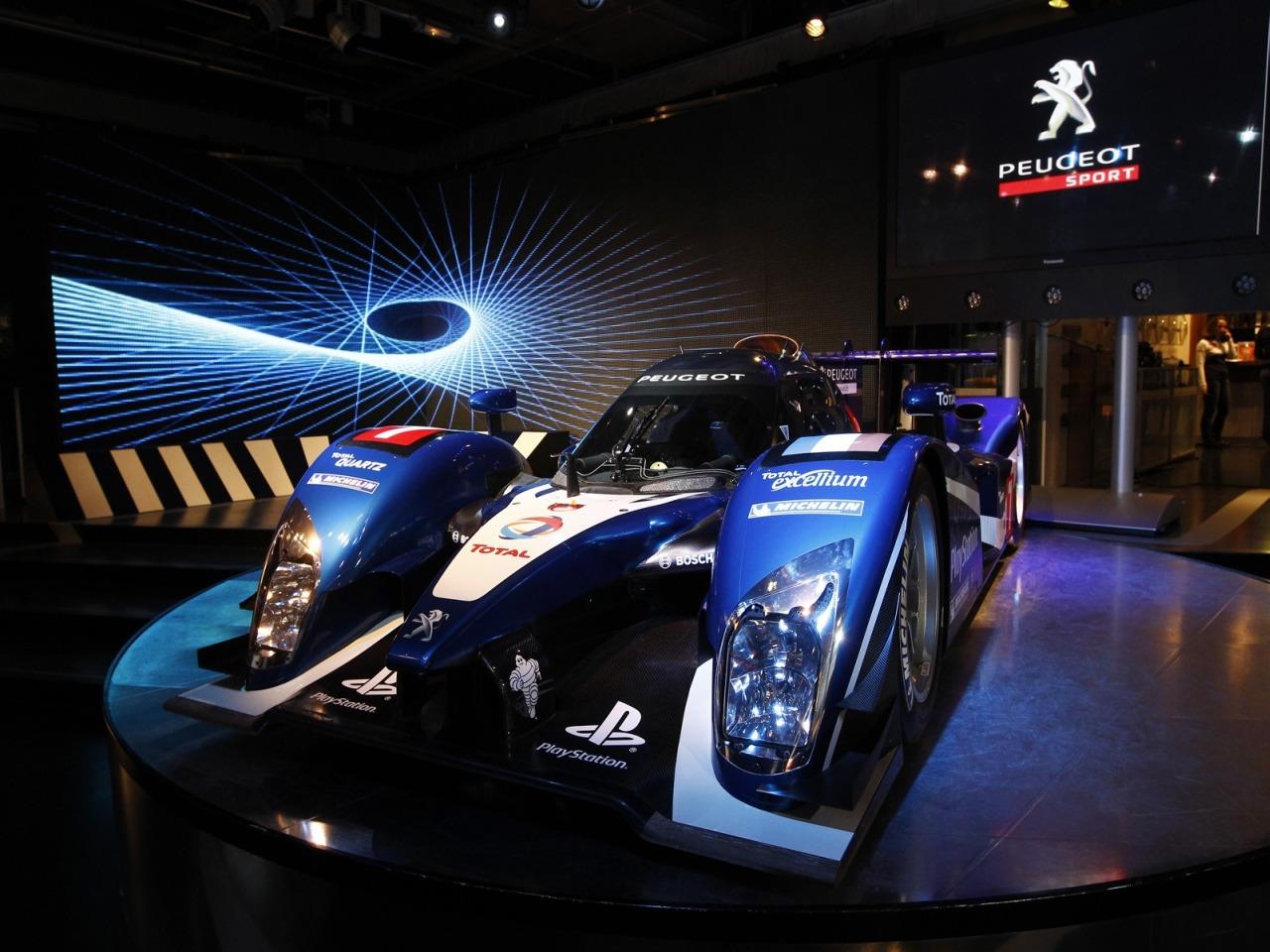 Peugeot unveils diesel powered 908 le mans race car for Garage peugeot le mans