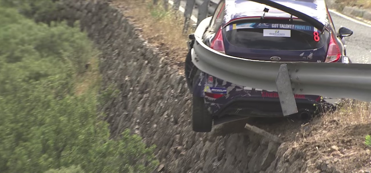 Rally driver avoids cliff tumble thanks to sturdy guardrail