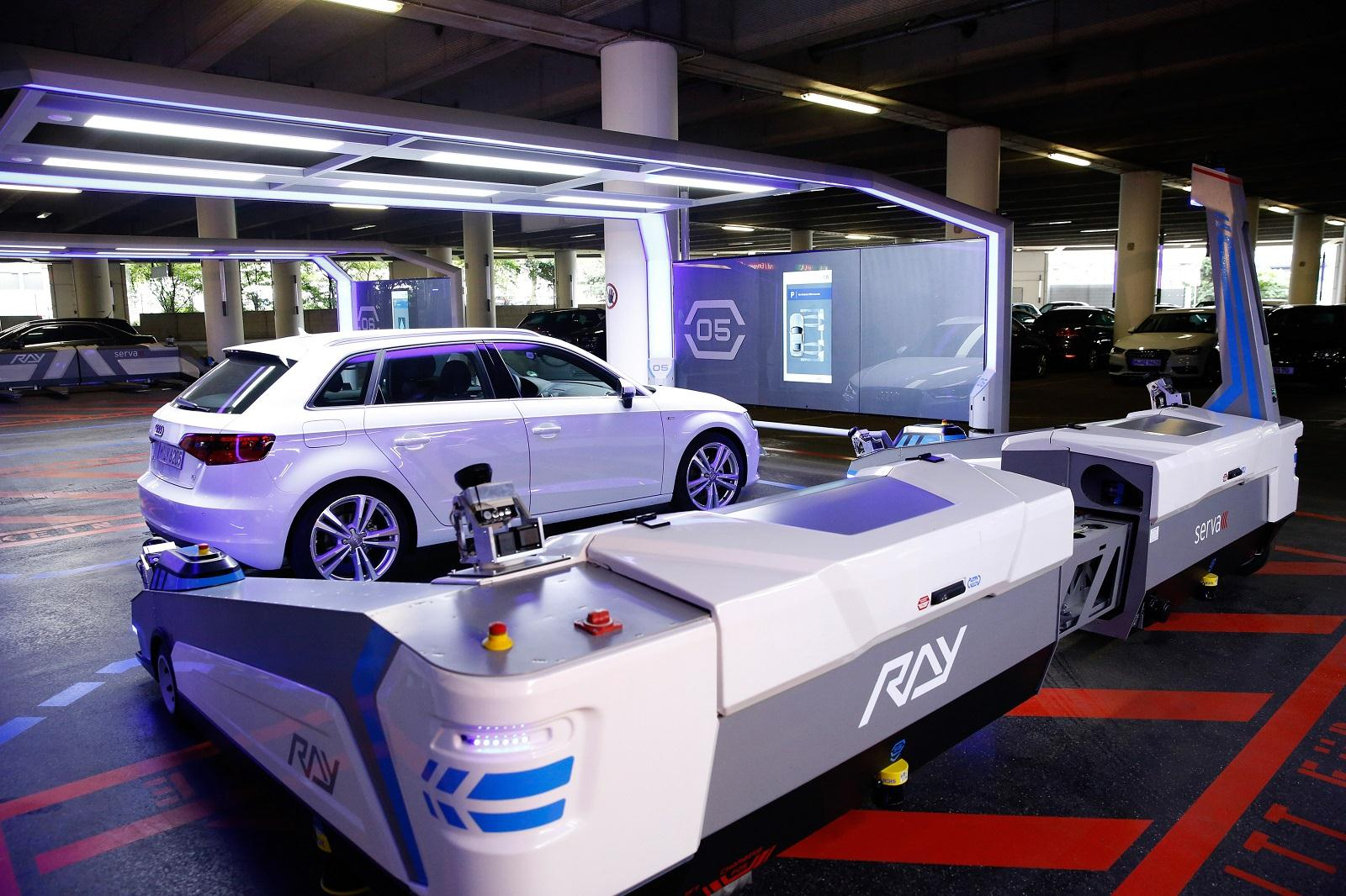 german airport introduces futuristic automatic parking. Black Bedroom Furniture Sets. Home Design Ideas
