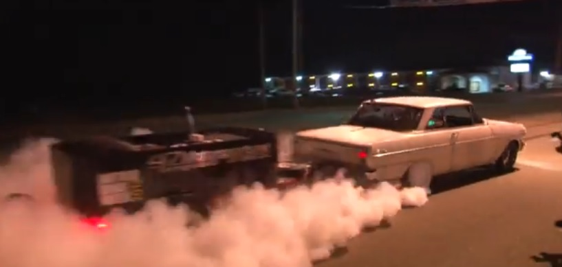 Watch an 1100 hp car do a burnout with a trailer video