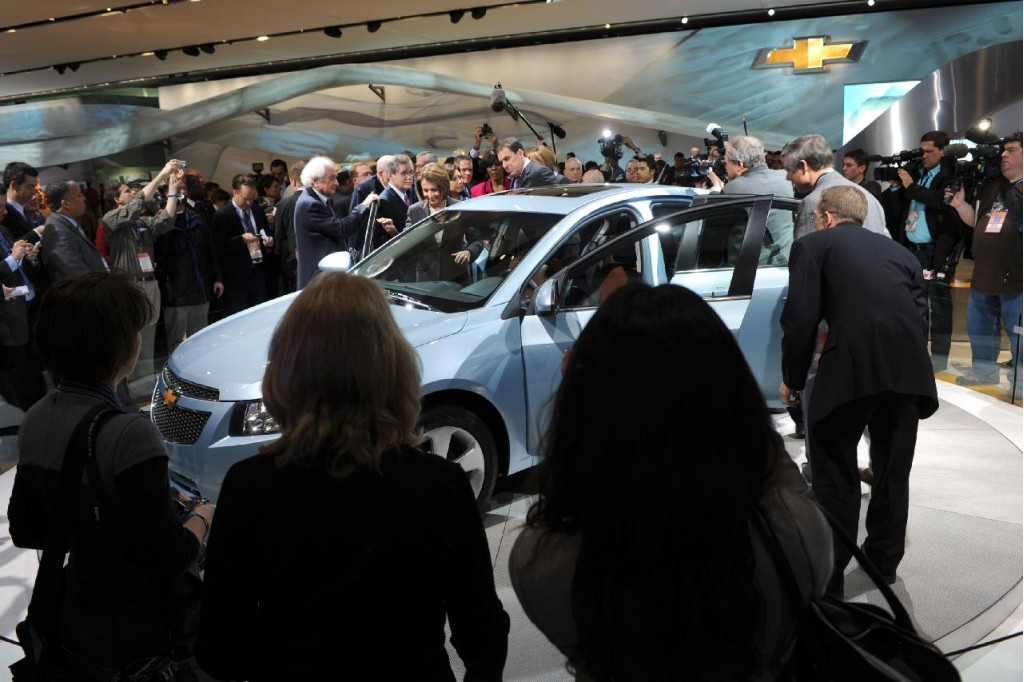 2010 Detroit Auto Show, with Speaker of the House Nancy Pelosi inspecting a 2011 Chevrolet Cruze