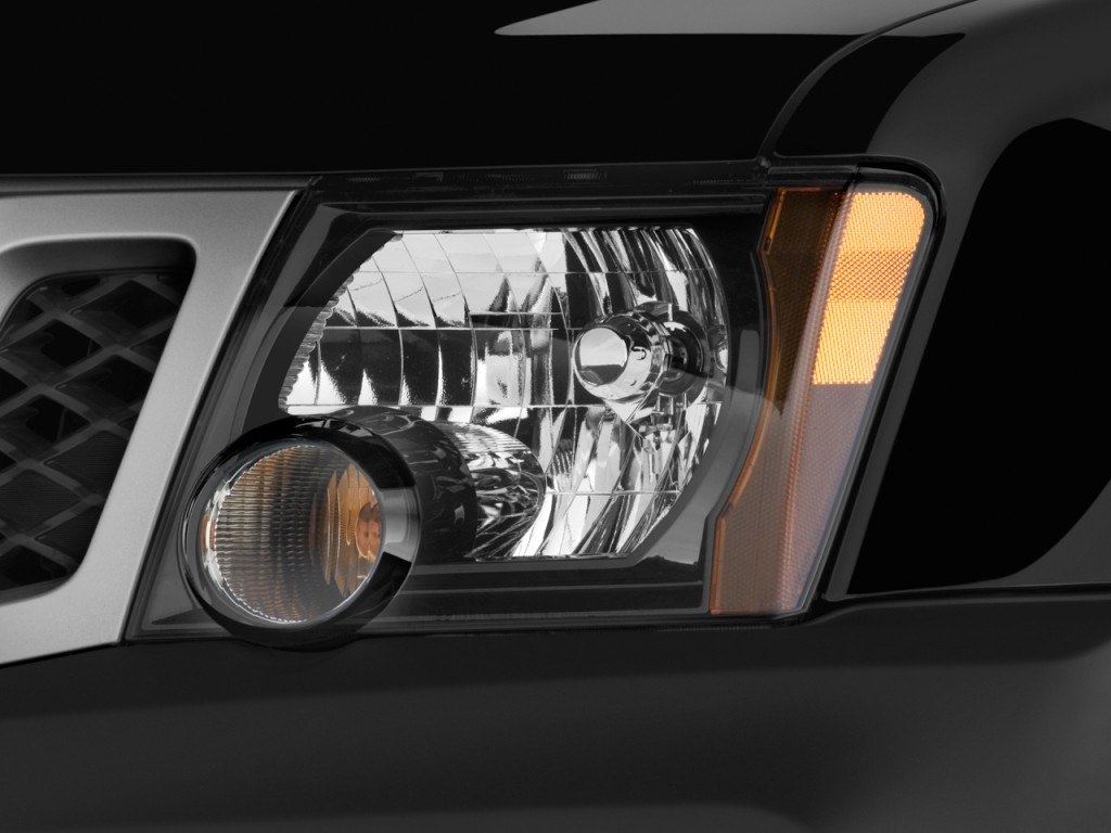 image 2010 nissan xterra 2wd 4 door auto x headlight. Black Bedroom Furniture Sets. Home Design Ideas