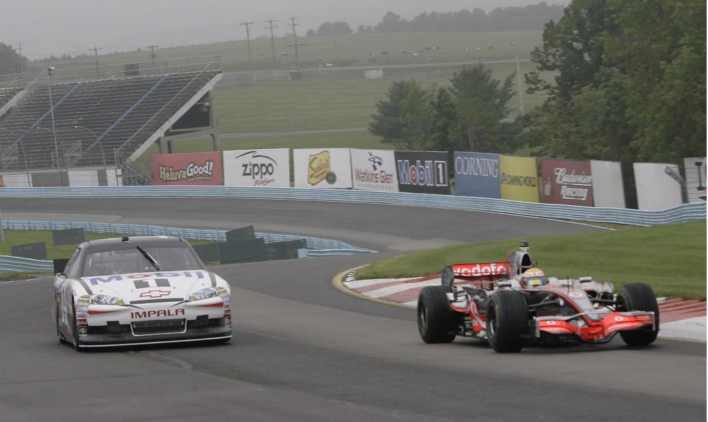 Tony Stewart and Lewis Hamilton swap cars at Watkins Glen, 2011