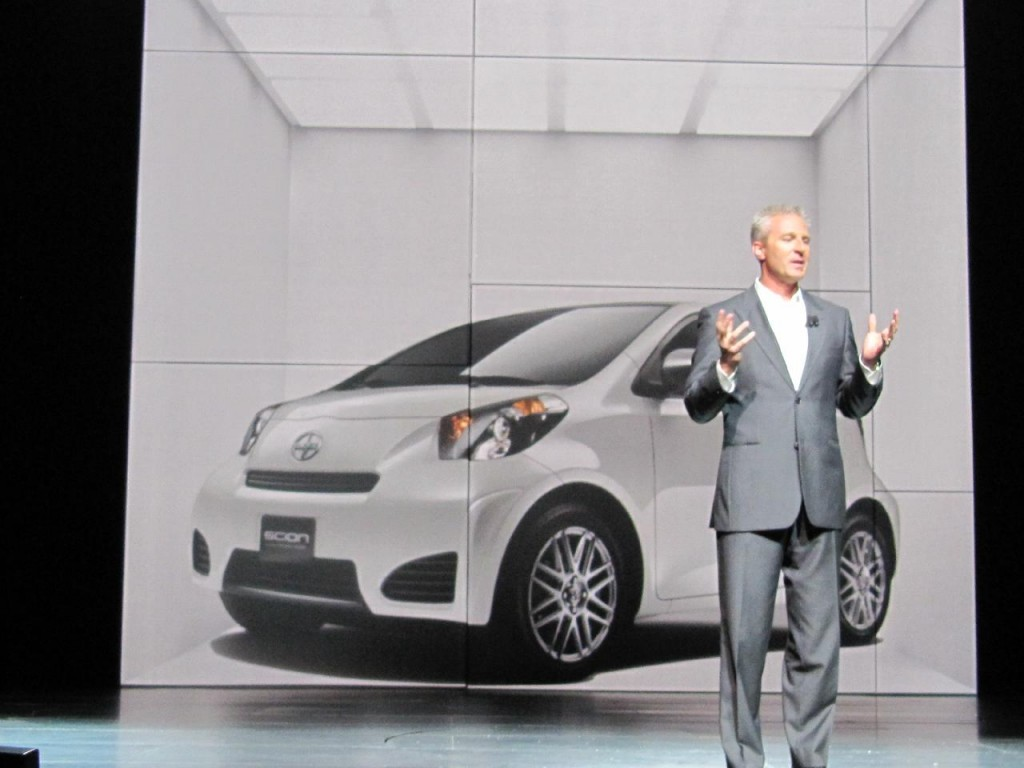 2011 Scion iQ at 2010 New York Auto Show, with Scion's Jack Hollis