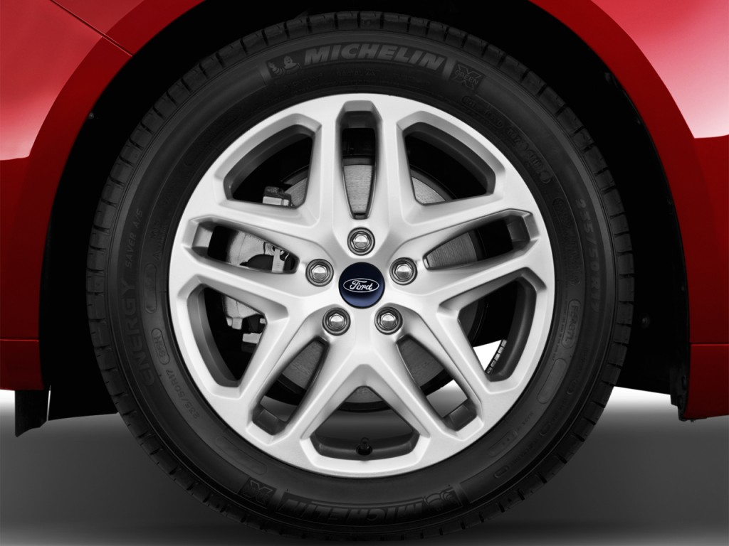 image 2014 ford fusion 4 door sedan se fwd wheel cap. Black Bedroom Furniture Sets. Home Design Ideas