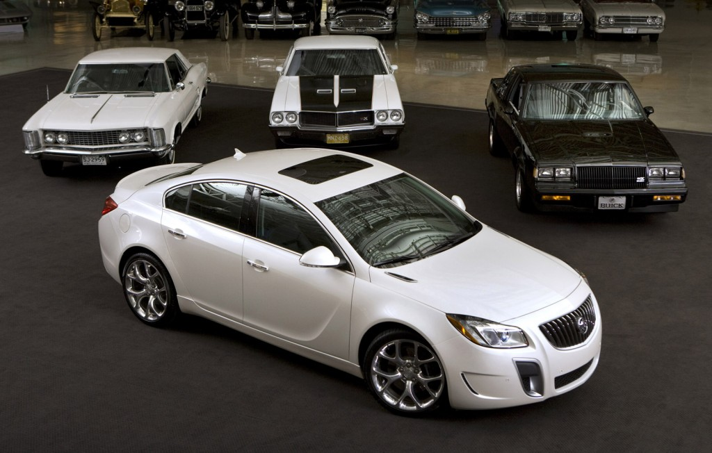 A 2012 Buick Regal GS in front of a 1963 Riviera, 1970 GSX and 1987 GNX