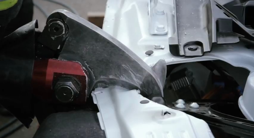 A hydraulic tool cuts apart the Tesla Model S