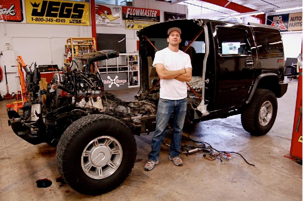 Artist Jeremy Dean with half a Hummer H2 for his work,