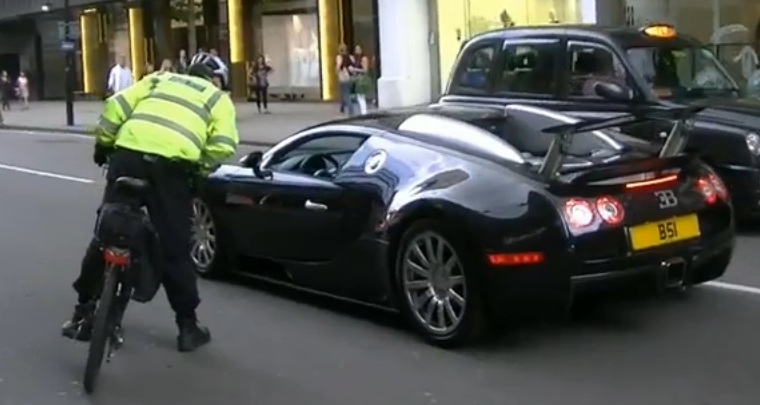 bugatti veyron pulled over by bike cop video. Black Bedroom Furniture Sets. Home Design Ideas
