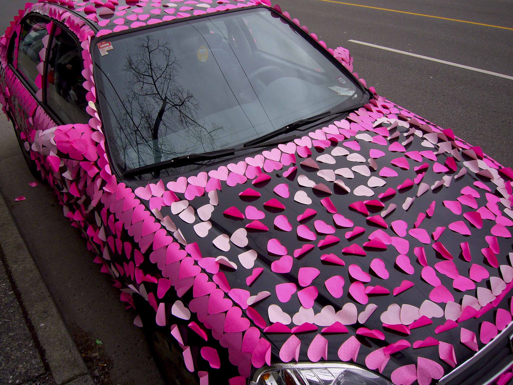 Car decorated with hearts (photo by Flickr user sashafatcat)