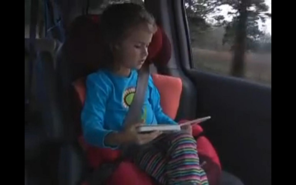 Child in booster seat -- from IIHS instructional video