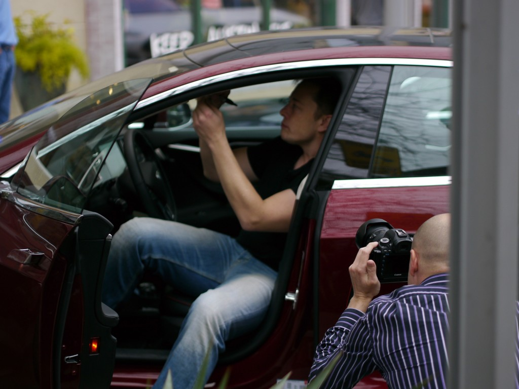 Elon Musk signs new 2013 Tesla Model S at Tesla Store opening, Austin, Texas [photo: John Griswell]