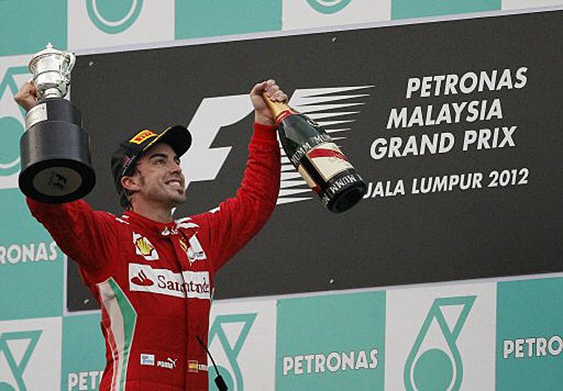 http://images.hgmsites.net/lrg/fernando-alonso-takes-top-podium-spot_100386241_l.jpg