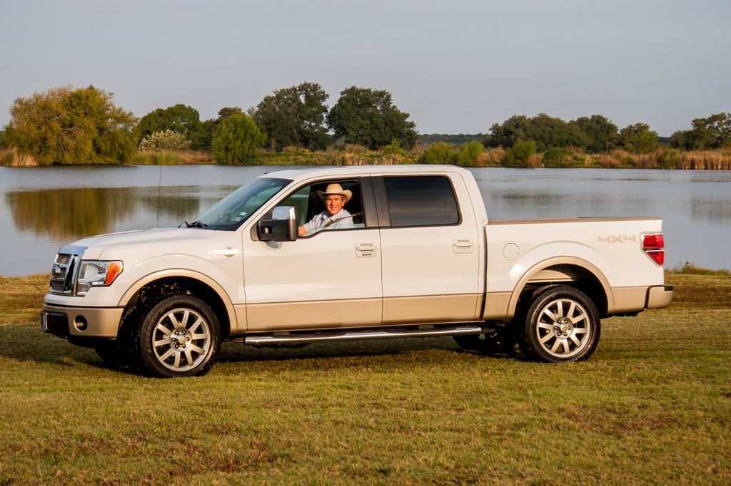 Former President George W. Bush in his 2009 Ford F-150 - image: Barrett-Jackson