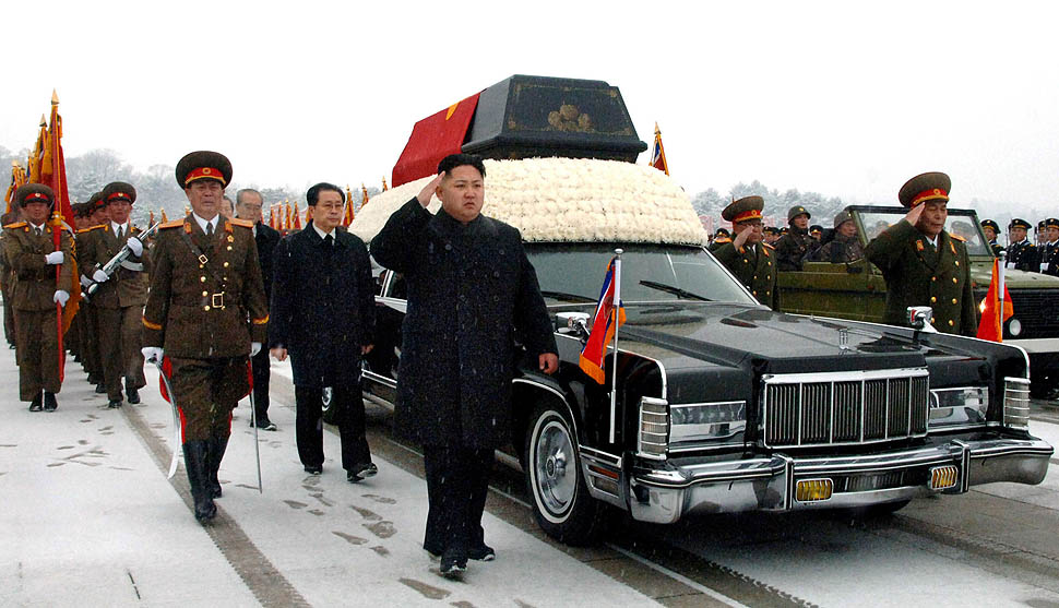 Funeral procession for Kim Jong-il, led by a Lincoln Continental