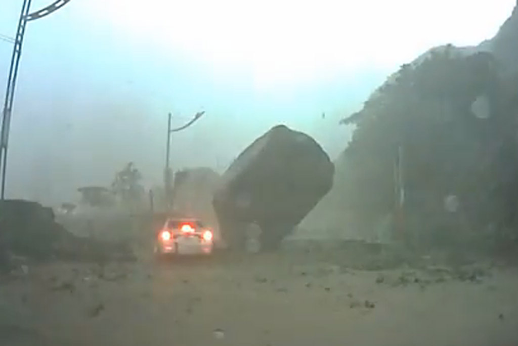 Giant Boulder almost crushes car during Taiwanese landslide