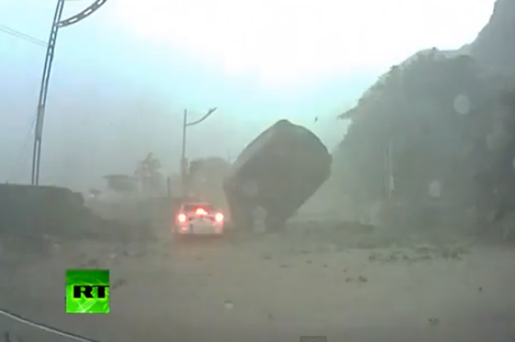 Giant Boulder almost crushes car during Taiwanese mudslide