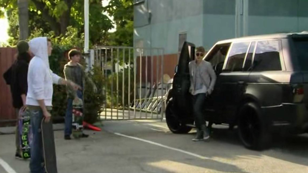 Justin Bieber steps out of his 'Kahn Branded' Range Rover in an L.A. car park