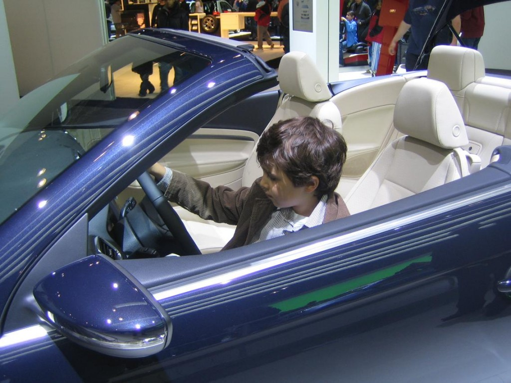 Luc at the NY Auto Show behind the wheel of a 2009 Volkswagen Eos