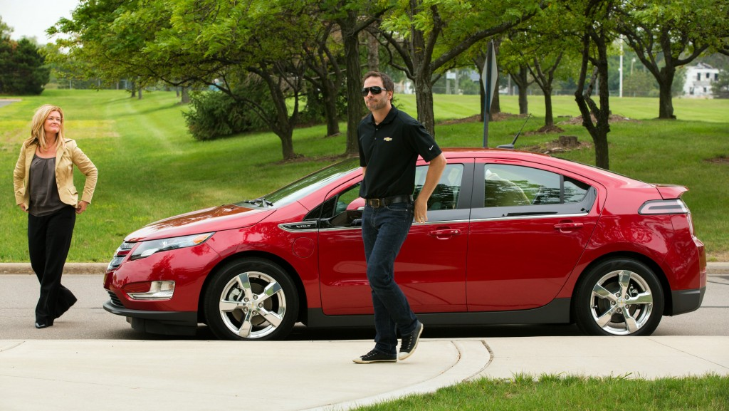 NASCAR racer Jimmie Johnson checks out the Chevrolet Volt