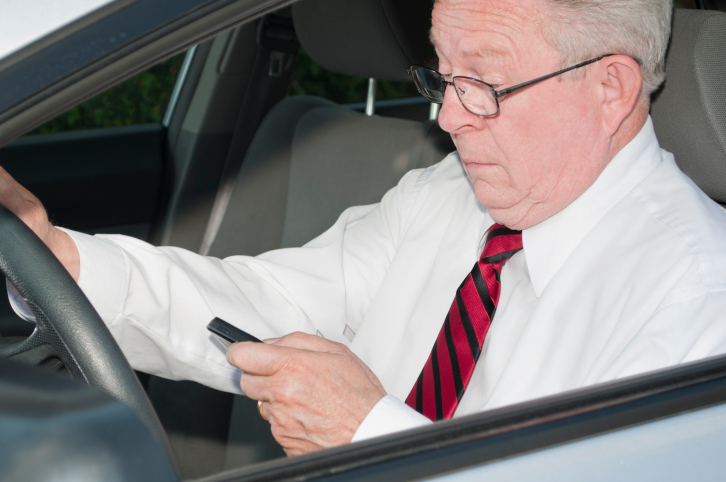 Older driver with phone