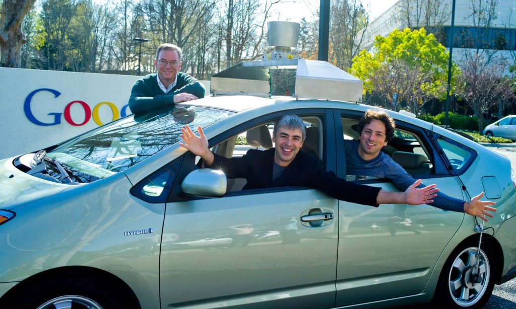 The founders of Google and one of their autonomous Toyota Prius hybrids