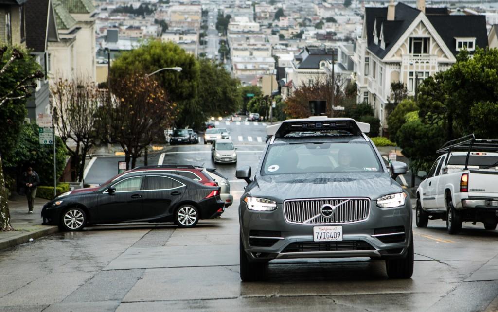 Uber's self-driving car guru steps aside in wake of lawsuit