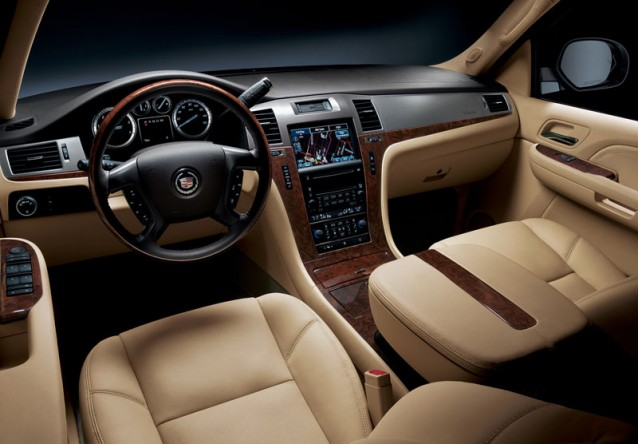The interior of the 2010 Cadillac Escalade is roomy, comfortable, and luxurious despite its truck roots
