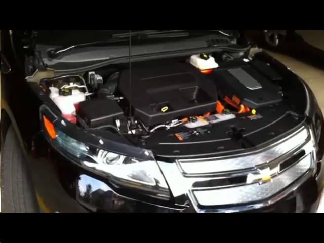 2011 Chevrolet Volt with hood open, showing range extender engine and Voltec drive