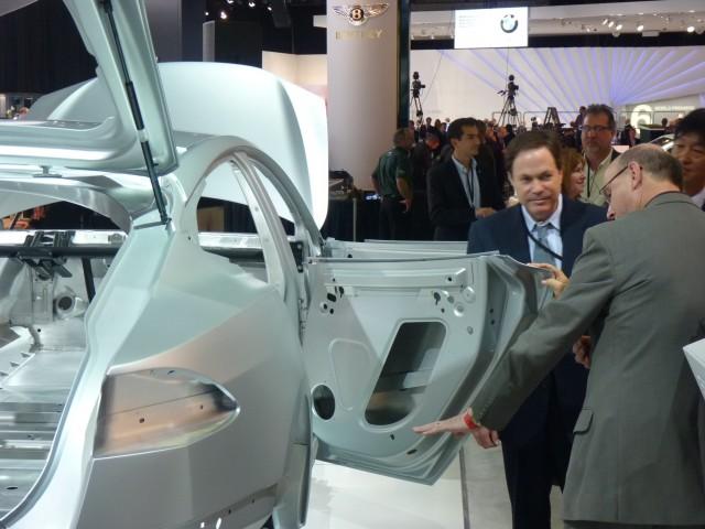 Toyota Motor Corporation president Akio Toyoda, at Tesla stand, 2011 Detroit Auto Show