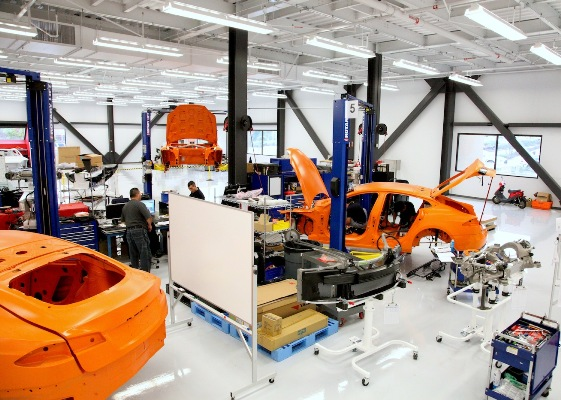 Tesla Model S workshop - cars to be crash-tested are painted orange