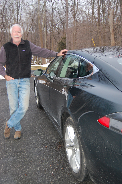 2013 Tesla Model S electric sport sedan on delivery day, with owner David Noland