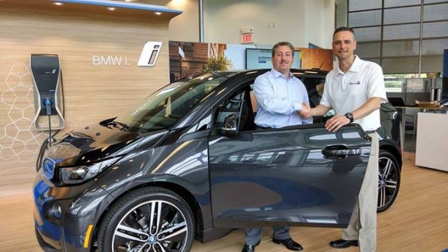 2014 BMW i3 REx range-extended electric car - buyer Tom Moloughney with salesman Manny Antunes