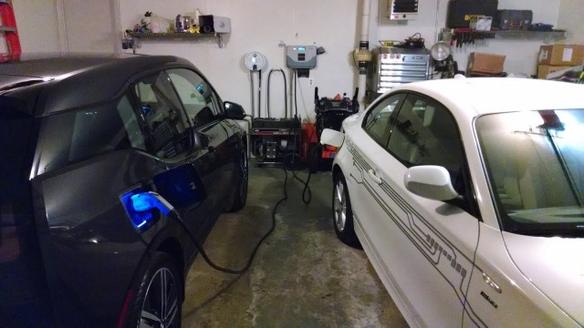 2014 BMW i3 REx range-extended electric car owned by Tom Moloughney - in garage with BMW ActiveE
