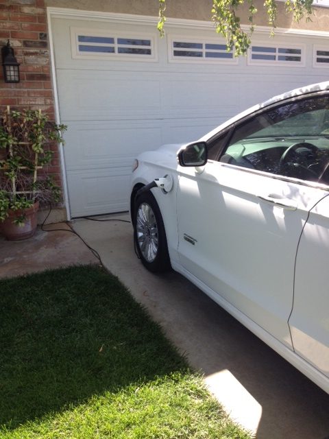 2014 Ford Fusion Energi charging in driveway [image provided by owner Brandt Buffham]