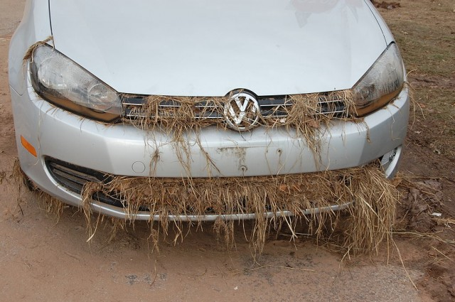 A car rendered inoperable by Hurricane Sandy: mud under the hood cakes the power plant, seaweed clogs the grill, and the headlights contain sea water. (Credit: Thomas Good)
