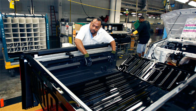 A UAW worker assembling a HUMMER H3T