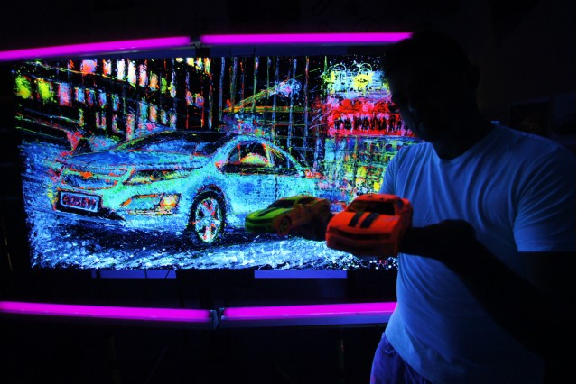 Artist Ian Cook's fluorescent Chevy Volt painting. Image: popbangcolour on flickr
