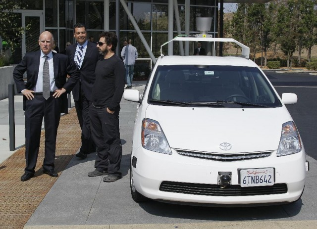 California Gov. Jerry Brown, left, California State Sen. Alex Padilla, center, and Google co-founder Sergey Brin beside a self-driving car at the Google headquarters.