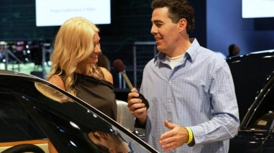 Carolla interviews manufacturer rep at NY Auto Show. Photo via SpeedTV.