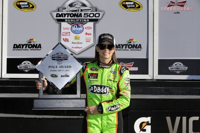 Danica Patrick poses with her Sprint Cup pole award - image: Stewart-Haas Racing