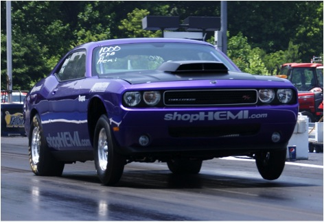 Daniels wheels her Dodge Challenger down the drag strip. Image courtesy of Tiff Daniels.