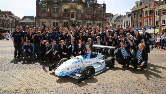 Delft University of Technology students and their DUT13 electric car