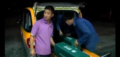 Electric Car Battery Swapping - Chinese Style - Screengrab from WallStreetDaily video on electric cars in China.