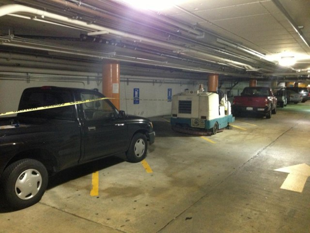 Electric-car charging stations blocked by garage staff in San Francisco garage [photo: Robert Olson]