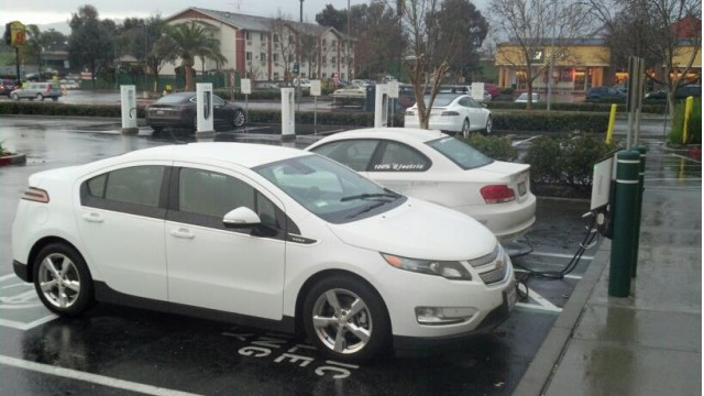 Electric cars at charging stations and Tesla SuperCharger stations in Gilroy, CA [photo: Jack Brown]