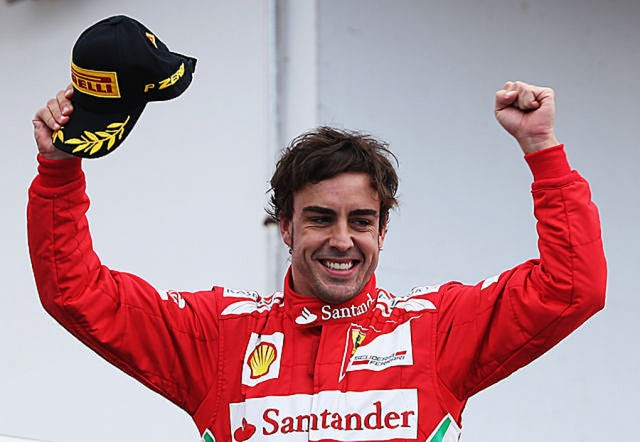 Fernando Alonso celebrates his third win this year