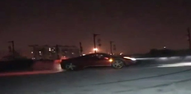 Ferrari 458 Italia doing donuts atop ancient Chinese wall