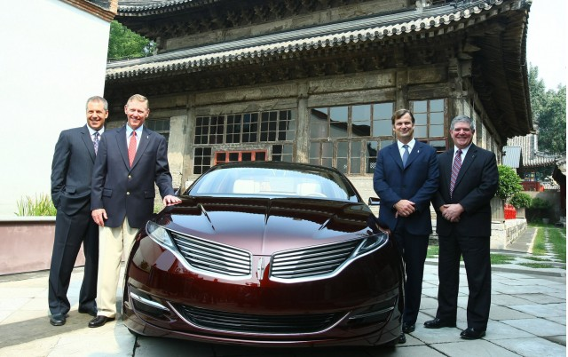 Ford's management team with the 2013 Lincoln MKZ